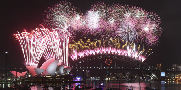 Fireworks explode over the Opera House and the Harbour Bridge during New Years Eve  celebrations in Sydney, Australia, Thursday, Jan. 1, 2015. Thousands of people crammed into Lady Macquaries Chair look-out to see the new year in and watch the annual fireworks show. (AP Photo/Rob Griffith)