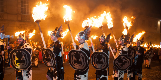 EDINBURGH, UNITED KINGDOM - DECEMBER 30: Men dressed as Vikings take part in the torchlight procession as it makes its way through Edinburgh for the start of the Hogmanay celebrations on December 30, 2014 in Edinburgh, Scotland. (Photo by Roberto Ricciuti/Getty Images)