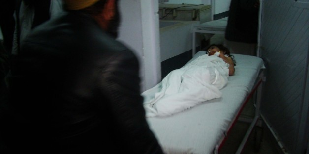 HELMAND, AFGHANISTAN - JANUARY 01: An Afghan kid, wounded by a missile attack on a wedding site in Helmand, is taken to Emergency Hospital in Lashkar Gah district of Helmand Province, Afghanistan on January 01, 2015. At least allegedly 20 people dead and 45 others wounded in this missile attack. (Photo by Abdul Hadi Roshan/Anadolu Agency/Getty Images)