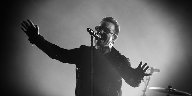 GLASGOW, SCOTLAND - NOVEMBER 09: (EDITORS NOTE: Image has been converted to black and white)  An alternative view of Bono of U2 during the MTV EMA's at The Hydro on November 9, 2014 in Glasgow, Scotland.  (Photo by Gareth Cattermole/MTV 2014/Getty Images for MTV)