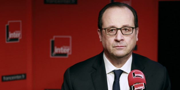 French President Francois Hollande  prepares to answer journalists' questions during a live interview on French radio station France Inter on January 5, 2015 in Paris