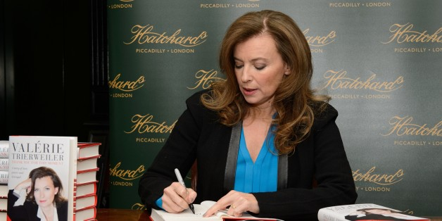 Former partner of French President Francois Hollande, Valerie Trierweiler, is pictured at Hatchards bookshop in central London, on November 25, 2014, as she signs copies of her book 'Merci pour ce moment' (Thank You For This Moment).  AFP PHOTO / LEON NEAL        (Photo credit should read LEON NEAL/AFP/Getty Images)