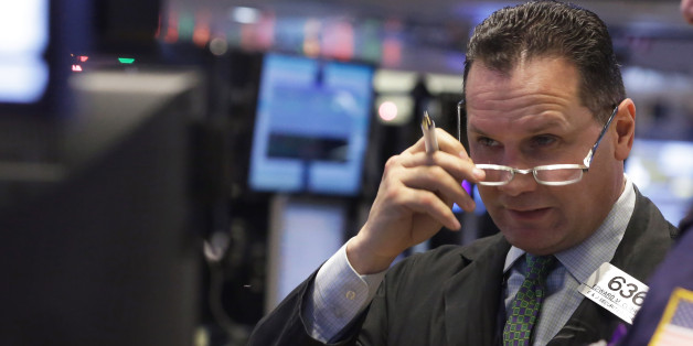 Trader Edward Curran works on the floor of the New York Stock Exchange Monday, Jan. 5, 2015. US stocks opened lower Monday, led by declines in energy stocks as the price of oil plunged again.  (AP Photo/Richard Drew)