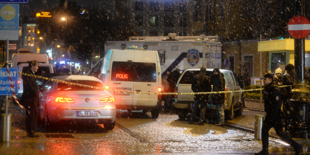 Turkish security gather outside a police station where one police officer was killed and another injured after a suicide bomber blew herself up in Istanbul, Turkey, Tuesday, Jan. 6, 2015. Istanbul governor Vasip Sahin said the woman entered the police station and reported a missing wallet before detonating a bomb. The attack occurred in the Sultan Ahmet district, a popular tourist destination. (AP Photo)