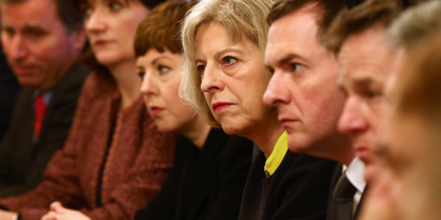 Home Secretary Theresa May and Chancellor George Osborne (centre right) at the first Cabinet meeting of 2015 at 10 Downing Street in London.