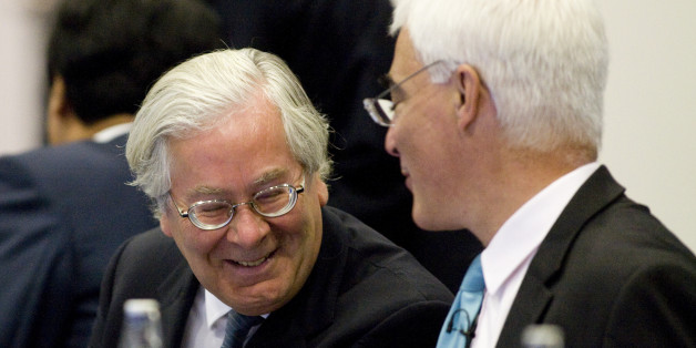 LONDON - SEPTEMBER 5:  Mervyn King, governor of the Bank of England (L) and Alistair Darling, U.K. chancellor of the exchequer, share a joke as they attend the opening session of the G20 finance ministers meeting, at the Treasury in Westminster on September 5, 2009 in London, England. British PM Gordon Brown has warned against withdrawing support for the global economy too soon, stating it could undermine tentative recovery signs, during a G20 meeting. Finance ministers are in London for a two-d