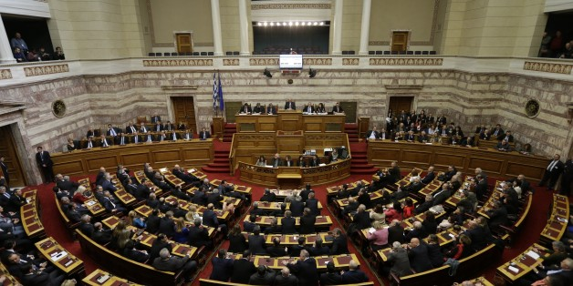 Greek lawmakers attend the third round of voting to elect a new Greek president at the Parliament in Athens on Monday, Dec. 29, 2014, as Greece heads to early general elections after parliament failed to elect a new president in a third and final round of voting. The coalition government's candidate for the post, the 73-year-old former European commissioner Stavros Dimas, garnered 168 votes from parliament's 300 seats, short of the 180 votes needed to win. (AP Photo/Thanassis Stavrakis