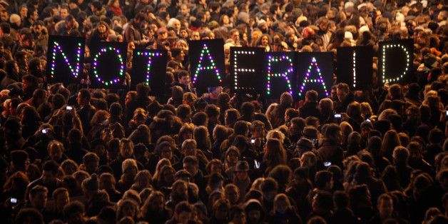 """People gather in solidarity of the victims of a terror attack against a satirical newspaper, in Paris, Wednesday, Jan. 7, 2015. Masked gunmen shouting """"Allahu akbar!"""" stormed the Paris offices of a satirical newspaper Wednesday, killing 12 people, including the paper's editor, before escaping in a getaway car. It was France's deadliest terror attack in living memory. (AP Photo/Thibault Camus)"""