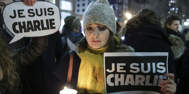 MOSCOW, RUSSIA - JANUARY 07: People hold banners and posters to show reactions against gun attack on the building of French magazine 'Charlie Hebdo' in Paris, leaving 12 dead, during the protest at Manhattan's Union Square in New York, United States on January 07, 2015. (Photo by Bilgin S. Sasmaz/Anadolu Agency/Getty Images)
