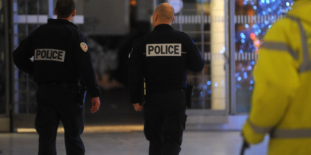 PARIS, FRANCE - JANUARY 08:  Police officers patrol the Gare du Nord railway station on January 8, 2015 in Paris, France. France's Vigipirate terrorist security plan is at it's maximum level in the country after twelve people were killed, including two police officers, at the offices of the French satirical publication Charlie Hebdo.  (Photo by Antoine Antoniol/Getty Images)