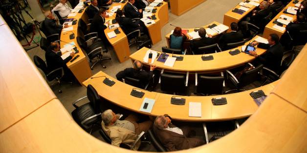 NICOSIA, CYPRUS - 2014/09/23: Members of the Parliament talking on the House floor. During a fiery session the House plenum on Tuesday agreed to discard one of the foreclosures-related bills which the President had refused to sign off on, but re-passed a second contentious bill with amendments. (Photo by Yiorgos Doukanar/Pacific Press/LightRocket via Getty Images)