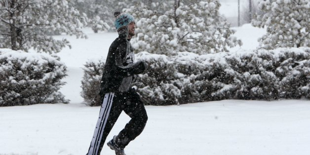 Christopher Joseph, a Rutgers University student,  jogs along a road in South Brunswick, N.J., during a snow storm Friday, Feb. 22, 2008. Joseph said he is training for a marathon and didn't want to stop his routine for the snow. (AP Photo/Mike Derer)