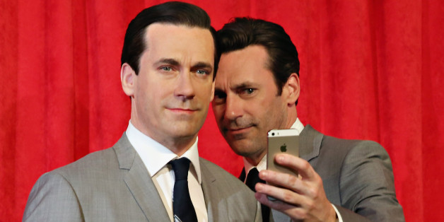 NEW YORK, NY - MAY 09: Actor Jon Hamm takes a selfie as he unveils Don Draper's wax figure during Mad Men's Final Season at Madame Tussauds New York on May 9, 2014 in New York City. (Photo by Cindy Ord/Getty Images for Madame Tussauds)