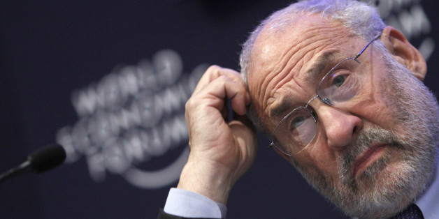 FILE - In this Jan. 26, 2011 file photo, Columbia University professor Joseph Stiglitz scratches his head during a session at the World Economic Forum in Davos, Switzerland. Stiglitz and others worry that too much money flowing to developing economies will form bubbles in stocks and housing prices that could burst. Such money has already inflated worldwide commodity prices to historic levels. (AP Photo/Virginia Mayo, file)