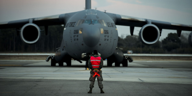 Airman 1st Class Damien Goodman marshals a C-17A Globemaster III before a flight Feb. 28, 2013, at Joint Base Charleston, S.C. Members of the 437th Aircraft Maintenance Squadron inspect, service, and maintain the C-17s to enable the aircraft to perform global airlift missions ranging from combat support operations and humanitarian relief to aeromedical evacuations. Goodman is a crew chief assigned to the 437th Aircraft Maintenance Squadron. (U.S. Air Force photo/ Senior Airman George Goslin)
