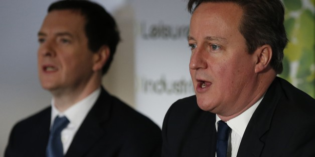 STOCKPORT, ENGLAND - JANUARY 9:  Prime Minister David Cameron (R) sits with Chancellor George Osborne during a meeting with local small business owners on January 9, 2015 in Stockport, England.  (Photo by Phil Noble - WPA Pool/Getty Images)
