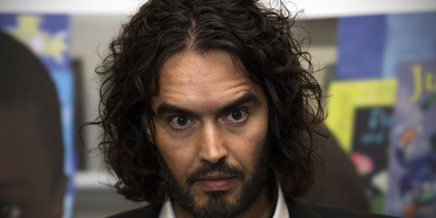 LONDON, ENGLAND - NOVEMBER 25:  Russell Brand poses for photographs as he arrives to deliver The Reading Agency Lecture at The Institute of Education on November 25, 2014 in London, England. Russell Brand will deliver 'a manifesto on reading' which will be in part personal, sharing his own experience of books and reading while growing up in the UK.  (Photo by Carl Court/Getty Images)