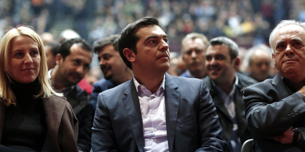 Alexis Tsipras, leader of the Syriza party, center, listens to a speaker during a pre-election party congress in Athens, Greece, on Saturday, Jan. 3, 2014. Greece's political parties embarked on a flash campaign for elections in less than three weeks that Prime Minister Antonis Samaras said will determine the fate of the countrys membership in the euro currency area. Photographer: Kostas Tsironis/Bloomberg via Getty Images