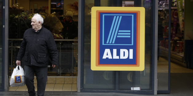 A customer exits an Aldi Stores Ltd. supermarket in the Kilburn district of London, U.K., on Monday, Dec. 22, 2014. German discounters Aldi and Lidl spent twice as much on British advertising as U.K. grocery leader Tesco Plc in the initial buildup to Christmas as they sought to build on market share gains at the seasonal peak. Photographer: Simon Dawson/Bloomberg via Getty Images
