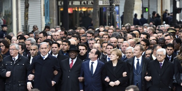 From left : European Commission President Jean-Claude Juncker, Israeli Prime Minister Benjamin Netanyahu, Malian President Ibrahim Boubacar Keita, French President Francois Hollande, German Chancellor Angela Merkel, European Union President Donald Tusk, Palestinian president Mahmud Abbas, and other heads of state take part in a Unity rally 'Marche Republicaine' on January 11, 2015 in Paris in tribute to the 17 victims of the three-day killing spree. The killings began on January 7 with an assaul