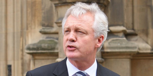 David Davis is pictured outside the House Of Commons in London this afternoon where he announced his resignation as shadow Home Secretary and Conservative MP.