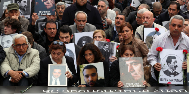 "Turkish and Armenian activists gather to protest the killings of Armenians during the last century in Turkey, in Istanbul, Turkey, Thursday, April 24, 2014, a day after Prime Minister Recep Tayyip Erdogan  has issued a conciliatory message to Armenians on the eve of the anniversary of the massacre of Armenians almost a century ago, calling the events of World War I ""our shared pain."" In a statement released Wednesday in nine languages - including Armenian - Erdogan said he hoped Armenians who lo"