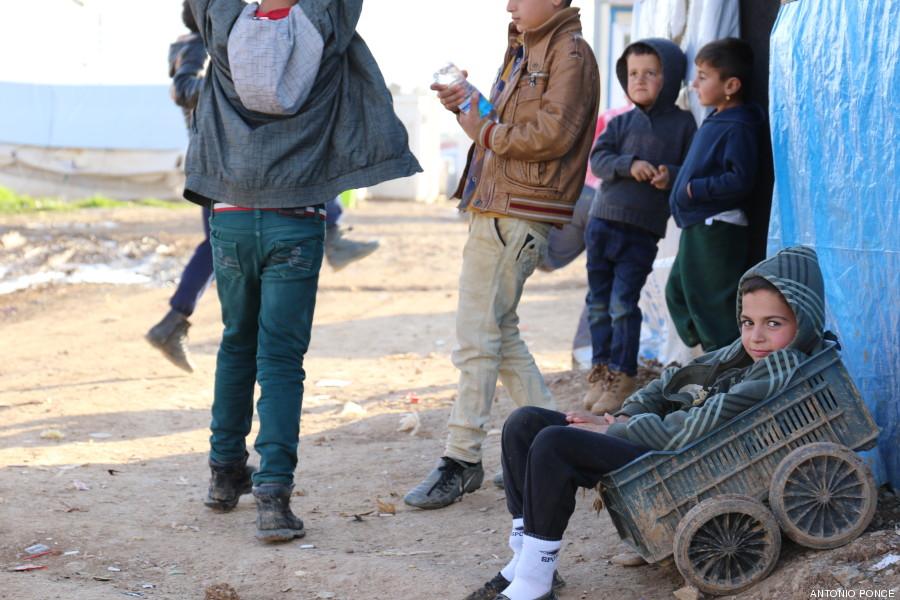 irak niño carreta