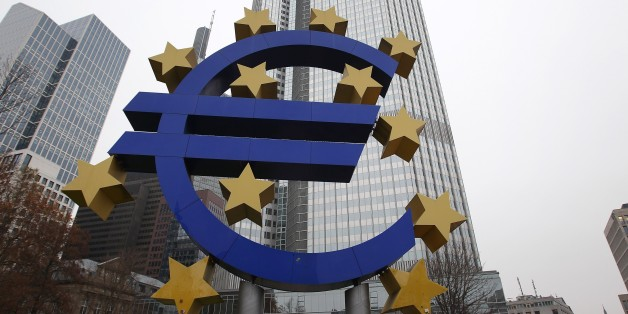 A sculpture featuring the EURO logo is pictured in front of the European Central Bank (ECB) in Frankfurt am Main, western Germany, December 2, 2014. The giant Euro logo will stay in downtown Frankfurt am Main despite the ECB headquarters moves to the city's eastern district of Ostend, its owner announced on December 1, 2014.       AFP PHOTO / DANIEL ROLAND        (Photo credit should read DANIEL ROLAND/AFP/Getty Images)