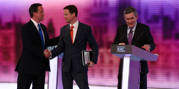 British opposition Conservative party leader, David Cameron (L), shakes hands with opposition Liberal Democrat leader, Nick Clegg (C), and Prime Minister, and leader of the ruling Labour Party, Gordon Brown (R), at the end of the live televised debate, at the University of Birmingham, in Birmingham, central England on April 29, 2010.  Britain's main party leaders squared up for the final pre-election TV debate Thursday.   AFP PHOTO/Gareth Fuller/Pool (Photo credit should read GARETH FULLER/AFP/G