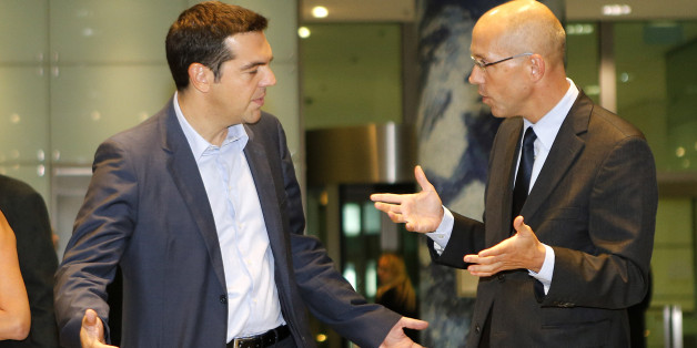 President of Greek SYRIZA party Alexis Tsipras and Director of European Central Bank Joerg Asmussen, from left, share a word after a meeting at the ECB in Frankfurt, Germany, Thursday, Sept.19, 2013. (AP Photo/Michael Probst)