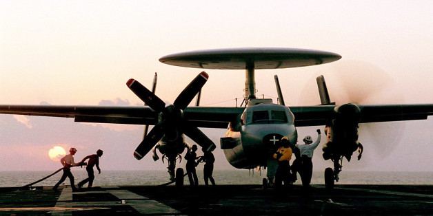 In this undated handout photo from the French Navy,  technicians refuel a hawkeye plane on the flight deck of the French nuclear-powered aircraft carrier Charles de Gaulle in the Indian ocean.  French military planes support U.S. jets with air missions focused on reconnaissance operations in Afghanistan.(AP Photo/ Marine Nationale, Patrick Fromentin)