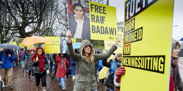 People take part in a protest by Amnesty International, for the immediate release of the Saudi blogger Raif Badawi, in front of the Saudi Embassy in The Hague, on January  15, 2015. Badawi put on the website 'Freed Saudi liberals 'and was arrested in 2012. He was sentenced to ten years in prison, converted 226,000 euro fine and a thousand lashes. AFP PHOTO / ANP / MARTIJN BEEKMAN ***netherlands out***        (Photo credit should read Martijn Beekman/AFP/Getty Images)