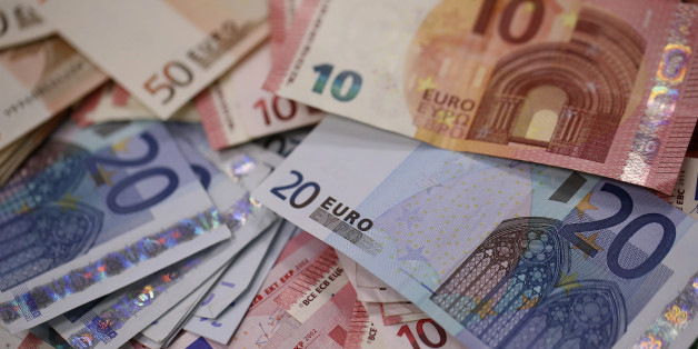 Multiple denomination euro banknotes are arranged for a photograph inside a Travelex store, operated by Travelex Holdings Ltd., in London, U.K., on Monday, Jan. 12, 2015. The euro approached a nine-year low against the dollar as European Central Bank officials fueled speculation the institution will start a program of government-bond buying as early as next week to stave off deflation. Photographer: Simon Dawson/Bloomberg via Getty Images