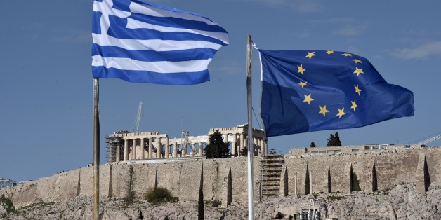 The Greek and EU flags flutter in front of the ancient Acropolis hill in Athens on January 15, 2014. Before snap elections were unexpectedly called in Greece on January 25, the troubled country was expected to finally limp out of recession after six painful years in the red. Now, with a clear electoral result far from certain, Greece's long-suffering business community fears that any chance of a tentative recovery will be delayed -- if not killed off outright -- by a damaging political stalemate.  AFP PHOTO / LOUISA GOULIAMAKI        (Photo credit should read LOUISA GOULIAMAKI/AFP/Getty Images)