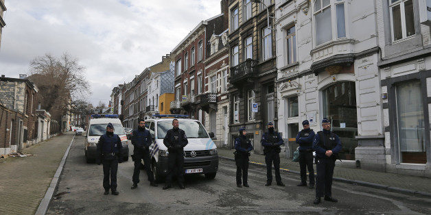 Belgian police officers guard a street in Verviers, Belgium, Friday, Jan. 16, 2015. Police  blocks a street after security forces took part in anti-terrorist raids in Verviers, eastern Belgium. Belgian authorities say two people have been killed and one has been arrested during a shootout in an anti-terrorist operation in the eastern city of Verviers. (AP Photo/Frank Augstein)