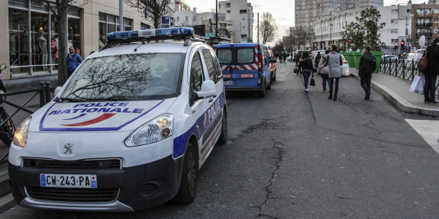 PARIS, FRANCE - JANUARY 16:  A police security cordon has been set up around the scene in the Hauts-de-Seine department northwest of Paris after a man, who had taken two hostages in a post office, is arrested by French Research and Intervention Brigades (BRI) police officers on January 16, 2015 in Colombes. (Photo by Onur Usta/Anadolu Agency/Getty Images)