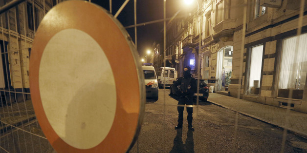 A Belgian police officer guards a street in Verviers, Belgium, Friday, Jan. 16, 2015. Belgian authorities say two people have been killed and one has been arrested during a shootout in an anti-terrorist operation in Verviers. (AP Photo/Frank Augstein)