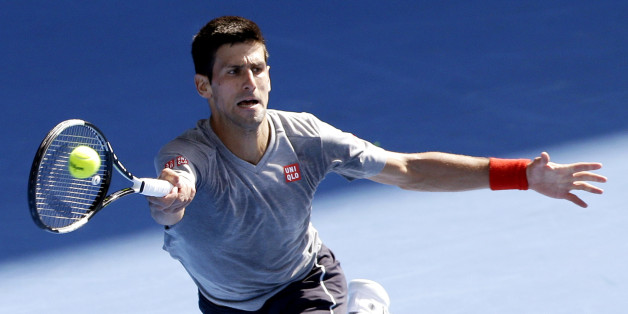 Novak Djokovic of Serbia returns a forehand shot during a training session at the Australian Open tennis championship in Melbourne, Australia, Sunday, Jan. 18, 2015. (AP Photo/Lee Jin-man)