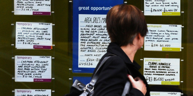A woman walks past a recruitment agency with adverts in the window in Liverpool on November 16, 2011. Britain's jobless rate hit a 15-year high of 8.3 percent in the three months to September, when youth unemployment surged past one million people for the first time, official data showed on November 16. AFP PHOTO / PAUL ELLIS (Photo credit should read PAUL ELLIS/AFP/Getty Images)