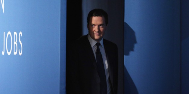 MANCHESTER, ENGLAND - SEPTEMBER 30:  Chancellor of the Exchequer George Osborne arrives to deliver his speech in the main hall on the second day of the Conservative Party Conference on September 30, 2013 in Manchester, England. Chancellor of the Exchequer George Osborne has unveiled a Government plan for long-term unemployed people to undertake work placements in order to receive their benefits.  (Photo by Oli Scarff/Getty Images)
