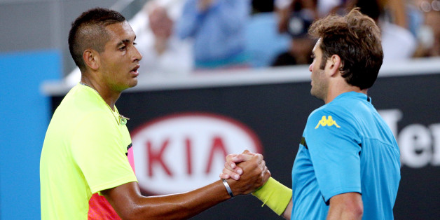 Nick Kyrgios of Australia, left,  is congratulated by Malek Jaziri of Tunisia after winning their third round match at the Australian Open tennis championship in Melbourne, Australia, Friday, Jan. 23, 2015. (AP Photo/Rob Griffith)
