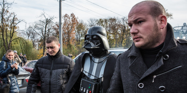 KIEV, UKRAINE - OCTOBER 24: Ukrainian parliamentary candidate Darth Viktorovich Vader (L) walks with other representatives of the Internet Party of Ukraine dressed as characters from Star Wars in central Kiev on October 24, 2014 in Kiev, Ukraine. The country's parliamentary elections, scheduled for Sunday, are seen as key to President Petro Poroshenko's ability to advance his agenda, stabilize the economy, and end fighting in the country's east. (Photo by Brendan Hoffman/Getty Images)