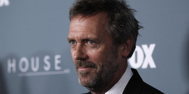 "Cast member Hugh Laurie arrives at the ""House"" series finale wrap party Los Angeles, Friday, April 20, 2012. (AP Photo/Matt Sayles)"