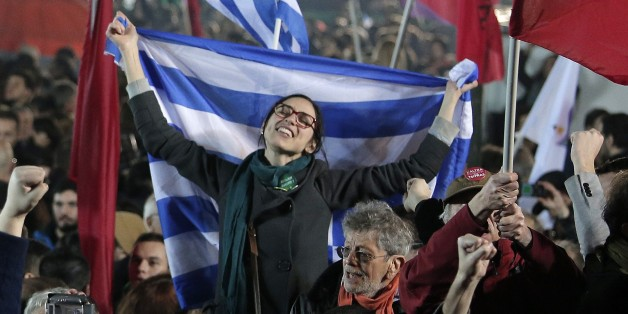 "A supporter of Alexis Tsipras leader of Syriza left-wing party holds the Greek flag during a rally outside Athens University Headquarters, Sunday, Jan. 25, 2015. A triumphant Alexis Tsipras told Greeks that his radical left Syriza party's win in Sunday's early general election meant an end to austerity and humiliation and that the country's regular and often fraught debt inspections were a thing of the past. ""Today the Greek people have made history. Hope has made history,"" Tsipras said in his v"