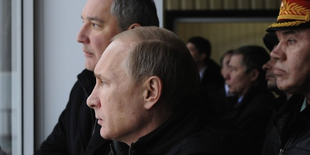 Russian President Vladimir Putin, centre visits the Central Scientific Research Institute of Precise Mechanical Engineering  in Klimovsk, near Moscow, Russia, Tuesday, Jan. 20, 2015. At rear is Deputy Prime Minister Dmitry Rogozin; and at right is  Chief of the General Staff of the Russian Armed Forces, Col.Gen. Valery Gerasimov. (AP Photo/RIA-Novosti, Mikhail Klimentyev, Presidential Press Service)