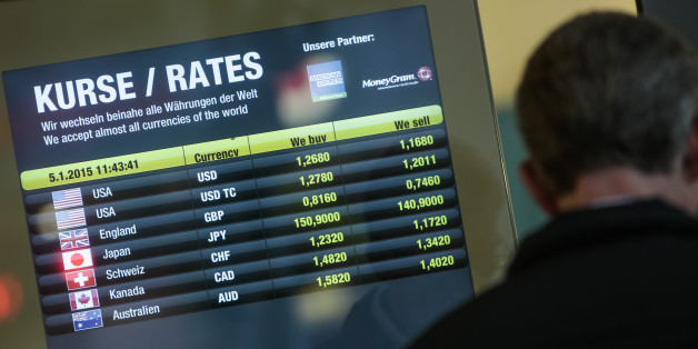 The exchange rate of the US Dollar  and  the Euro, at top, is displayed in the window of a currency exchange office in Berlin, Monday, Jan. 5, 2015. The euro sank to a nine-year low Monday as new doubts surfaced about Greece's commitment to the common currency bloc. European stocks mostly rose while Asian markets were mixed. (AP Photo/Markus Schreiber)