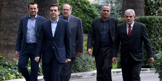 ATHENS, GREECE - JANUARY 26:  Syriza party leader Alexis Tsipras (2nd left) leaves after being sworn in by Greek President Karolos Papoulias as Greece's new Prime Minister at the Presidential Palace on January 26, 2015 in Athens, Greece. Alexis Tsipras was sworn in with a secular oath, rather than the traditional Greek Orthodox ceremony, becoming the youngest man to hold the post of Prime Minister in 150 years. The radical left party Syriza won the snap Greek general election and has asked the r