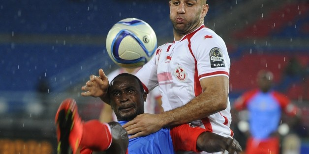 BATA, EQUATORIAL GUINEA - JANUARY 26: Tunisia's Aymen Abdennour (R) in action against Congo's Firmin Mubele Ndombee (L) during the 2015 African Cup of Nations Group B soccer match between Gabon and Congo at Bata Stadium in Bata, Equatorial Guinea on January 26, 2015. (Photo by Mohamed Hossam/Anadolu Agency/Getty Images)