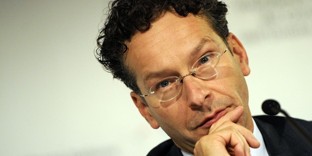 """Chairman of the so-called Eurogroup of finance ministers Jeroen Dijsselbloem speaks at a meeting, in Milan, Italy, Friday, Sept. 12, 2014. Eurozone finance ministers on Friday signaled their support for Draghinomics, backing European Central Bank head Mario Draghi's call for greater structural reforms to ensure investor confidence. Chairman of the so-called Eurogroup of finance ministers Jeroen Dijsselbloem said the European Central Bank's monetary police """"needs to be complemented by a credible mix of fiscal policies, structural reforms and investment,"""" as the eurozone's efforts shift from ensuring financial stability to promoting growth. (AP Photo/Giuseppe Aresu)"""