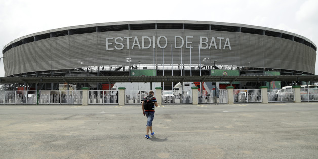 A man walks in front of the Bata stadium in Bata, Equatorial Guinea, Friday Jan. 16, 2015 which will host the opening African Cup of Nations Group A soccer match on Saturday between the tournament hosts and Congo. (AP Photo/Themba Hadebe)